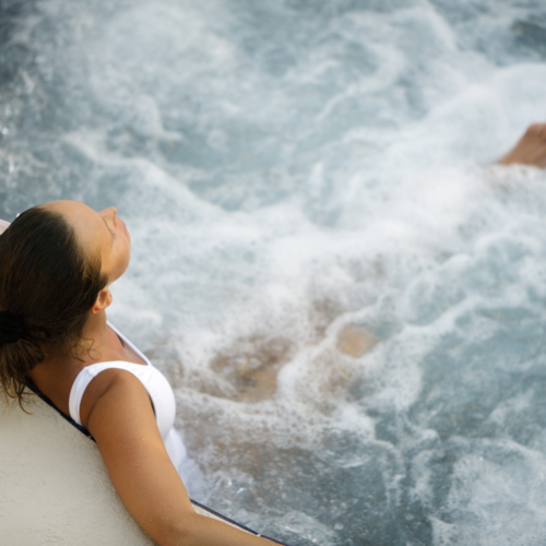 Aerial View Of Lady Relaxing In Hot Tub