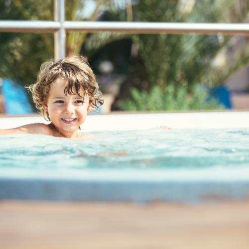 Young Boy Swimming In Spa Pool